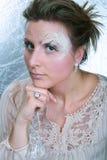 Frau mit einem Winterverfassungskonzept Stockfotografie