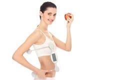 Frau mit einer Gewichtskala Stockbilder