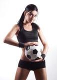 Frau mit einer Kugel Stockfotografie