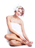 Frau mit einer Lilie Stockfotos