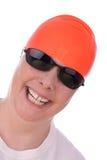 Frau mit einer orange Swimschutzkappe Stockfotos
