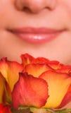 Frau mit einer Rose Stockfotografie