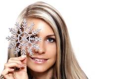 Frau mit einer Schneeflocke Lizenzfreie Stockbilder