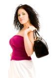 Frau mit einer schwarzen Handtasche Stockfotografie