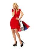 Frau mit Einkaufenbeuteln Stockfoto