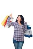 Frau mit Einkaufenbeuteln oben zeigend Lizenzfreies Stockfoto
