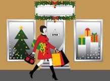 Frau mit Einkaufstasche und Geschenk Stockfoto