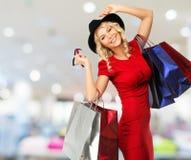 Frau mit Einkaufstaschen Lizenzfreies Stockbild