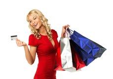 Frau mit Einkaufstaschen Stockfotos