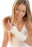 Frau mit elastischem wristban Stockfotos