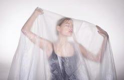 Frau mit Folie Stockfotografie