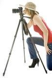 Frau mit Fotokamera und -stativ Stockfotografie