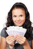 Frau mit Geldgebläse Stockfoto