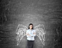 Frau mit gemalten Flügeln Lizenzfreie Stockfotografie