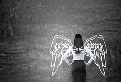 Frau mit gemalten Flügeln Lizenzfreie Stockfotos