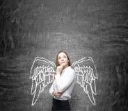 Frau mit gemalten Flügeln Stockfoto