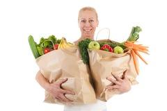 Frau mit gesundem Gemüse und Frucht Stockbilder