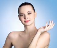 Frau mit gesunder sauberer Haut Stockfotografie