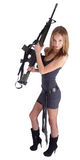 Frau mit Gewehr auf Weiß Stockfotos