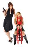Frau mit Gewehr und Geisel Lizenzfreie Stockfotos