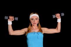 Frau mit Gewichten Lizenzfreie Stockfotografie