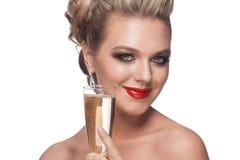 Frau mit Glas Champagner Stockfotos