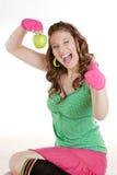 Frau mit grünem Apfel stockbilder