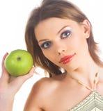 Frau mit grünem Apfel Stockfotos