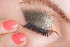 Frau mit grünes Auge smokey bilden, Schönheit stockbilder