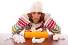 Frau mit Grippesymptomen Stockbild