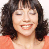 Frau mit großem glücklichem Lächeln Stockfotos