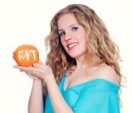 Frau mit großer Zitrusfrucht Lizenzfreies Stockfoto