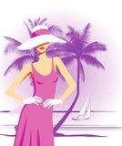Frau mit Hut am Strand Stockbilder