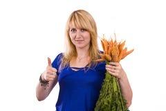 Frau mit Karotte Stockfotos
