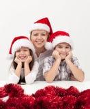Frau mit Kindern zur Weihnachtszeit Lizenzfreies Stockfoto