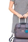 Frau mit Koffern Stockfotos