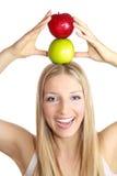 Frau mit Kopf der Äpfel O Stockfotos