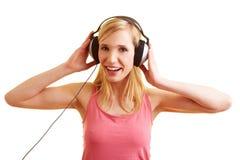 Frau mit Kopfhörern Stockfotografie
