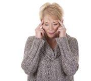 Frau mit Kopfschmerzen Lizenzfreie Stockfotografie