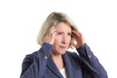 Frau mit Kopfschmerzen oder Migräne Stockbild