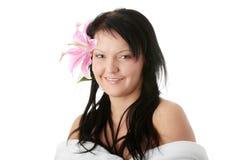 Frau mit Lilienblume Lizenzfreie Stockfotografie