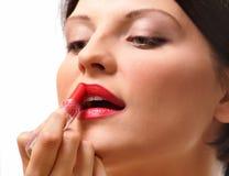 Frau mit Lippenstift Stockfotografie