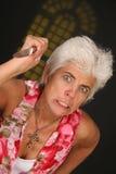 Frau mit Messer lizenzfreies stockbild
