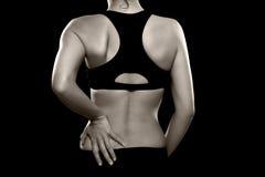 Frau mit niedrigeren Rückenschmerzen Stockfoto