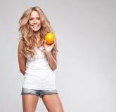 Frau mit Orange Lizenzfreie Stockfotografie