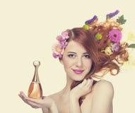 Frau mit Parfüm Stockfotos