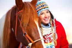 Frau mit Pferd Stockfotos