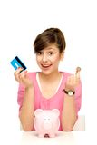 Frau mit piggy Querneigung Lizenzfreie Stockfotos