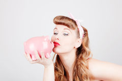 Frau mit piggy Querneigung stockfotos