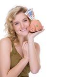 Frau mit piggybank Stockfotografie